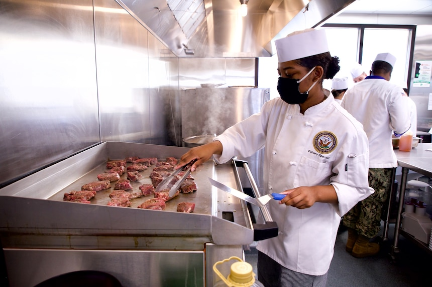 A Sailor assigned the the Freedom-variant littoral combat ship USS Sioux City (LCS 11) prepares beef tenderloin steaks while taking part in a week-long course on baking and scratch cooking techniques. After a year of closure due to the COVID-19 pandemic, culinary specialists returned to the Naval Supply Systems Command (NAVSUP) Fleet Logistics Center (FLC) Jacksonville training galley at Naval Station Mayport.