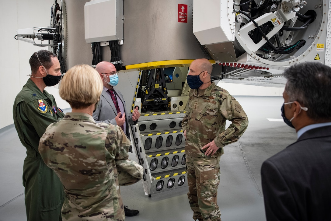 Dr. David Burch, Airman Systems Directorate's Airman Biosciences Division, Lt. Col. Nathan Maertens, Aerospace Physiology Division Chief at the USAF School of Aerospace Medicine, Air Force Research Laboratory commander, Brig. Gen. Heather Pringle and Dr. Rajesh Naik, 711th Human Performance Wing Chief Scientist stand in front of the centrifuge and discuss aerospace physiology partnerships with Gen. David Allvin, Air Force Vice Chief of Staff, during his visit to AFRL's 711 HPW Apr. 26, 2021 at Wright-Patterson Air Force Base, Ohio. (U.S. Air Force photo/Richard Eldridge)