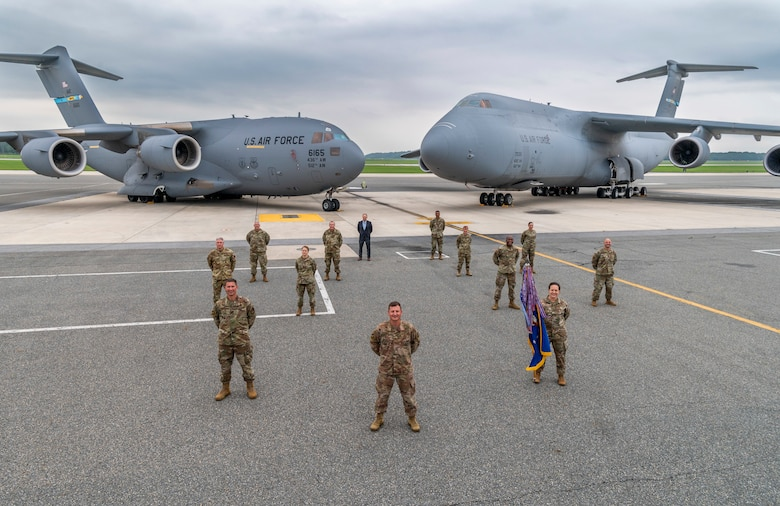 Leadership from the 436th Airlift Wing, Dover Air Force Base, Delaware, take a group photo Sept. 11, 2020, on the flight line at Dover AFB. The 436th AW operates the C-17 Globemaster III and C-5M Super Galaxy aircraft. (U.S. Air Force photo by Senior Airman Christopher Quail)