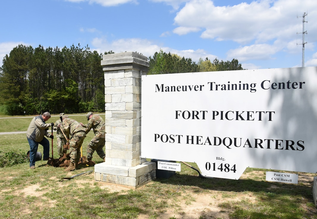 Virginia National Guard Soldiers and civilian employees of Maneuver Training Center Fort Pickett plant two trees at the MTC garrison headquarters in honor of Earth Day April 22, 2021, at Fort Pickett, Virginia.