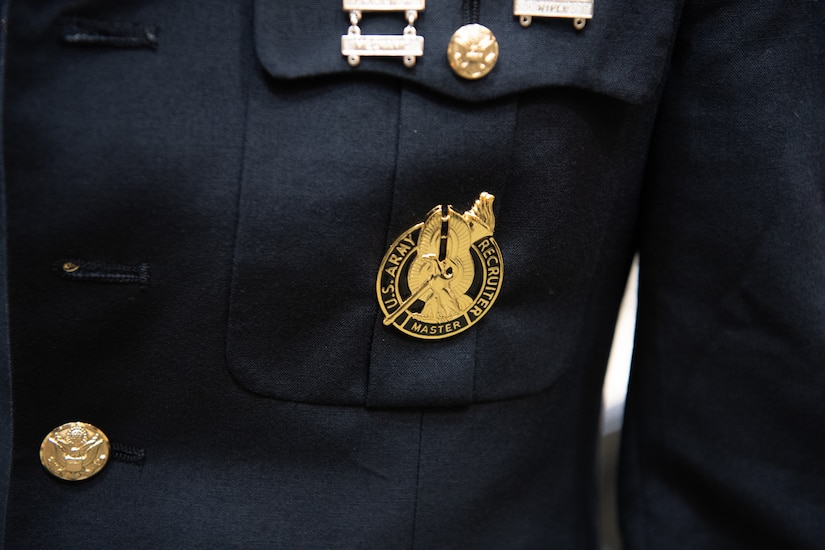 photos of an army badge and group of Soldiers receiving their badge.