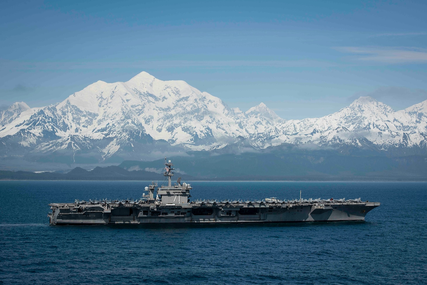 The aircraft carrier USS Theodore Roosevelt (CVN 71) transits the Gulf of Alaska after participating in exercise Northern Edge 2019.