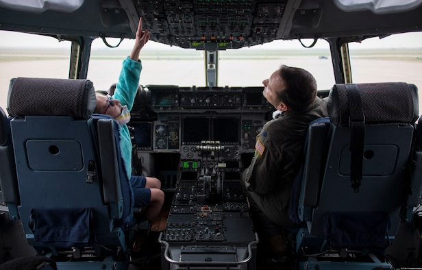 Lt. Col. Rebb Jones, 97th Operations Group deputy commander, shows his 11-year-old daughter, Karly, the cockpit of a C-17 Globemaster III during a 5th grade student tour, April 29, 2021, at Altus Air Force Base, Oklahoma. During their tour, students interacted with three static displays and had the opportunity to learn about the technology inside the cockpits. (U.S. Air Force photo by Airman 1st Class Amanda Lovelace)