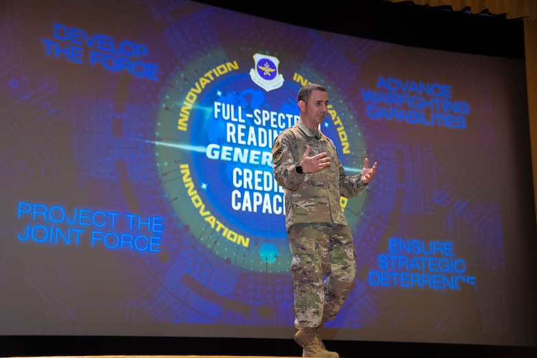 Chief Master Sgt. Brian Kruzelnick, the Air Mobility Command (AMC) command chief, speaks during a commander's call at MacDill Air Force Base, Fla., April 28, 2021.