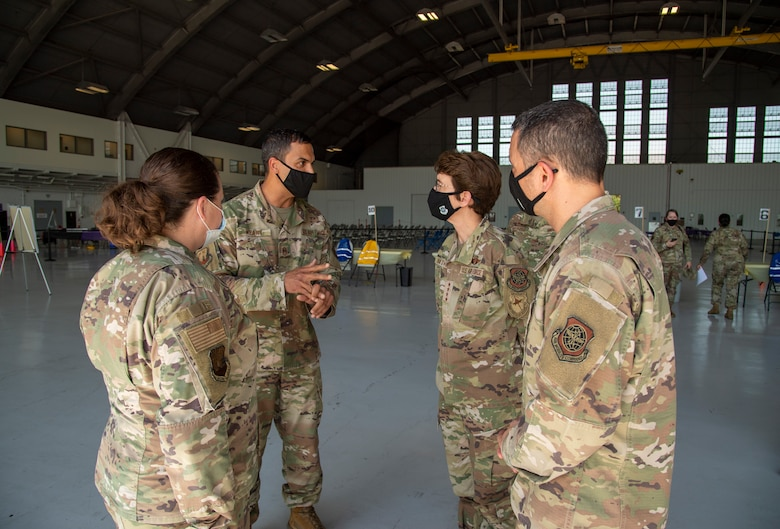 Air Mobility Command (AMC) Commander, Gen. Jaqueline Van Ovost, and AMC Command Chief, Chief Master Sgt. Brian Kruzelnick, speak to Airmen from the 6th Medical Group during their visit to MacDill Air Force Base, Fla., April 28, 2021.