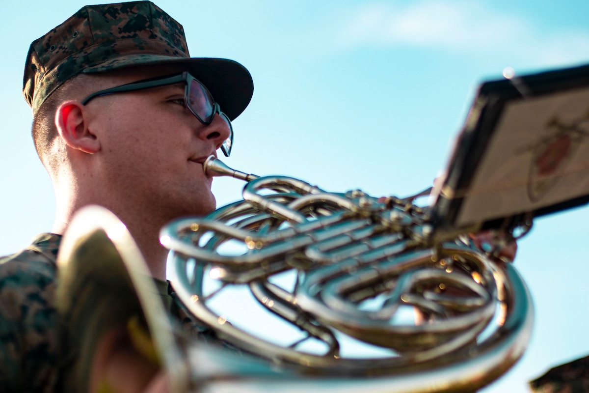 A Marine plays an instrument.