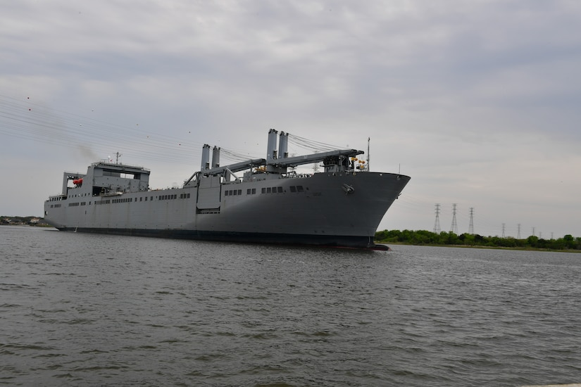 A large ship moves through the water.