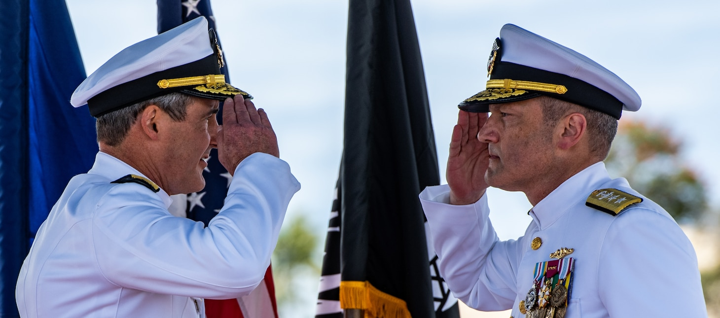 JOINT BASE PEARL HARBOR-HICKAM (April 29, 2021) -- Rear Adm. Blake Converse, from Montoursville, Pennsylvania, salutes Rear Adm. Jeffrey Jablon, from Frostburg, Maryland, during a change of command ceremony for Commander, Submarine Force, U.S. Pacific Fleet, held on the brow of the Virginia-class fast-attack submarine USS North Carolina (SSN 777). Jablon relieved Converse as the 43rd commander, Submarine Force, U.S. Pacific Fleet, at the ceremony held on the historic submarine piers on Joint Base Pearl Harbor-Hickam. (U.S. Navy photo by MC1 Michael B. Zingaro/Released)
