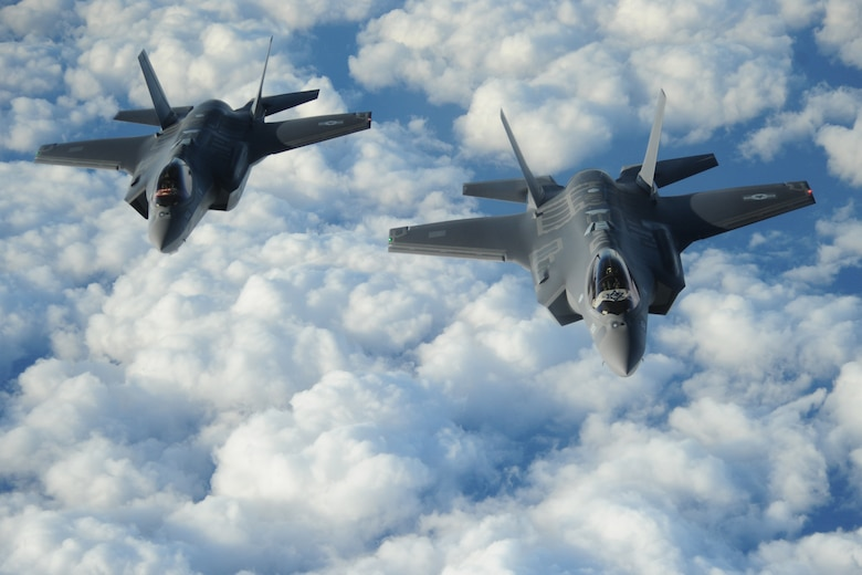 """Two Israeli F-35 """"Adirs"""" fly in formation and display the U.S. and Israeli flags after receiving fuel from a Tennessee Air National Guard KC-135, Dec, 6, 2016. The U.S. Army Corps of Engineers and Israeli partners recently celebrated the delivery of additional hardened hangars and associated facilities that support the Israeli Air Force's fleet of F-35 fighter jets. The United States has partnered with Israel for several years on its F-35 program through the Foreign Military Finance, or FMF, program where the two nations partner on construction of strategic facilities. (U.S. Air Force photo by 1st Lt. Erik D. Anthony)"""