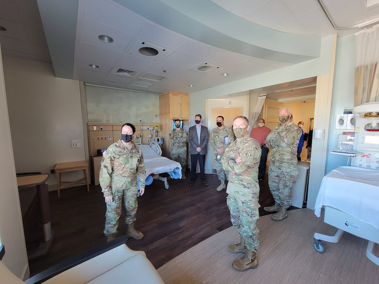 Weed Army Community Hospital's commander Col. Nancy Parson, left, briefs U.S. Army Corps of Engineers Deputy Commanding General for Military and International Operations Maj. Gen. Jeffrey L. Milhorn, center, and U.S. Army Corps of Engineers South Pacific Division Commander Brig. Gen. Paul Owen, right, about the Mother-Baby unit, which features labor and delivery, recovery and postpartum rooms, one C-Section suite and a nursery during an April 26 tour of the hospital.