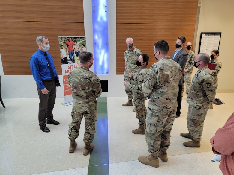 Weed Army Community Hospital's Commander Col. Nancy Parson, center right, briefs U.S. Army Corps of Engineers Deputy Commanding General for Military and International Operations Maj. Gen. Jeffrey L. Milhorn, second from left, during an April 26 tour of the hospital at Fort Irwin, California.