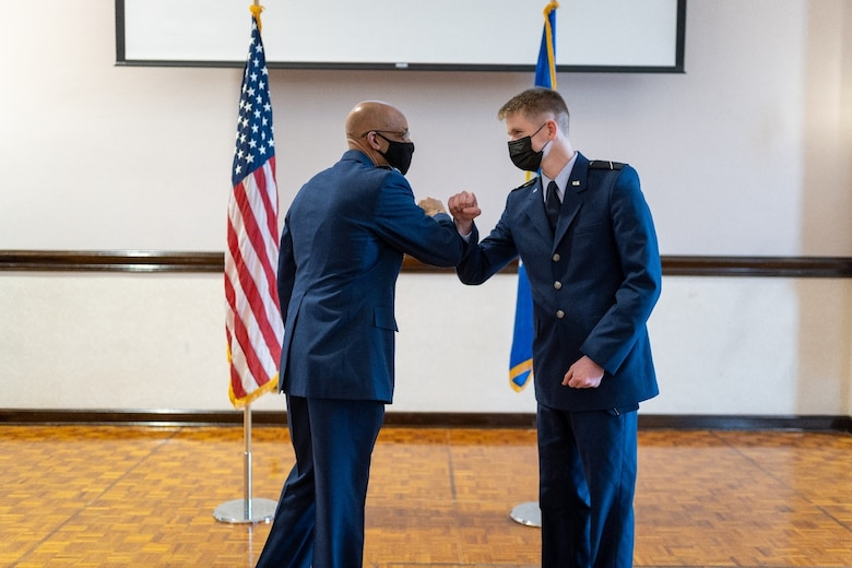Air Force Chief of Staff Gen. Charles Q. Brown, Jr. presents a coin for excellence to U.S. Air Force