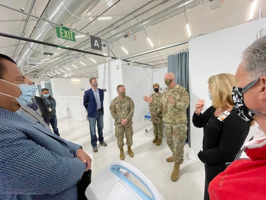 Maj. Gen. Jeffrey Milhorn, U.S. Army Corps of Engineers deputy commanding general for Military and International Operations, center left, listens as Brig. Gen. Paul Owen, the Corps' South Pacific Division commander, center right, talks about the Corps' FEMA mission in support of LA-area hospitals during an April 28 tour of Adventist Health White Memorial Hospital in the Boyle Heights neighborhood of Los Angeles.
