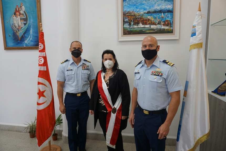 Lt. Cmdr. Samuel Blase (left), USCGC Robert Goldman (WPC 1142), and Lt. Cmdr. Steve Hulse (right), USCGC Charles Moulthrope (WPC 1141) with the Mayor of La Goulette, Tunisia, Ms. Amel Limam, upon arrival April 22, 2021. Charles Moulthrope and Robert Goldman are en route to their new homeport in Bahrain in support of the Navy's U.S. Fifth Fleet and U.S. Coast Guard Patrol Forces Southwest Asia.