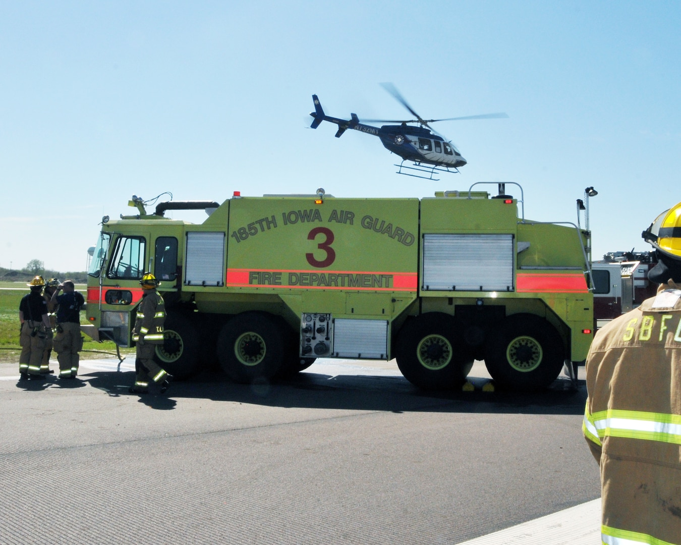 A helicopter from Wings Air Rescue arrives at Sioux Gateway Airport Col. Bud Day Field to pick up a load of simulated casualties to deliver to a hospital during a Federal Aviation Administration mass casualty exercise at the airport in Sioux City, Iowa, May 1, 2021. The Iowa Air National Guard's 185th Air Refueling Wing participated in the exercise.