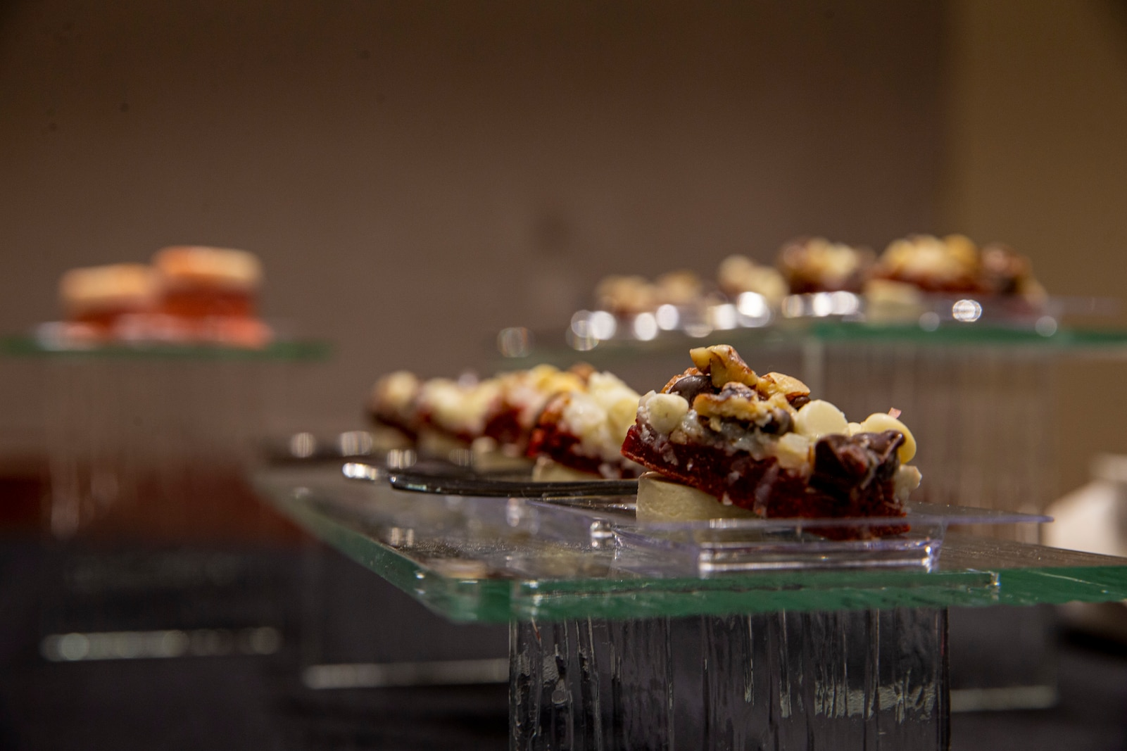 Red velvet seven layer bars are placed on display at a reception before the Friday Evening Parade at Marine Barracks Washington, D.C., April 30, 2021.