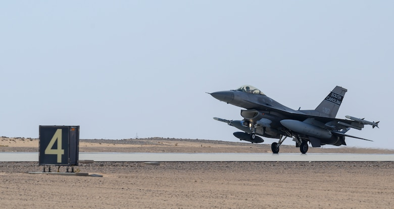 "A U.S. Air Force F-16CJ Fighting Falcon from South Carolina Air National Guard's 169th ""Swamp Fox"" Fighter Wing lands on the flight line at Prince Sultan Air Base, Kingdom of Saudi Arabia, April 14, 2021. The Swamp Fox team has been deployed to PSAB to help bolster the defensive capabilities against potential threats in the region. (U.S. Air Force Photo by Senior Airman Samuel Earick)"