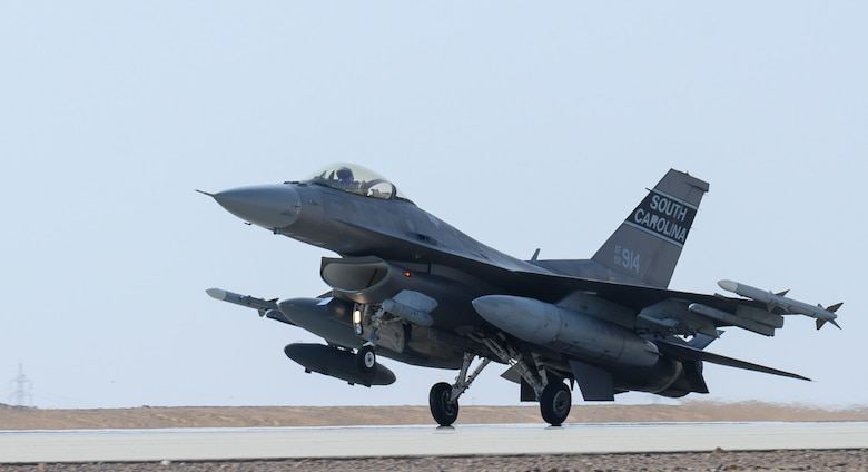 "A U.S. Air Force F-16CJ Fighting Falcon from South Carolina Air National Guard's 169th ""Swamp Fox"" Fighter Wing lands on the flight line at Prince Sultan Air Base, Kingdom of Saudi Arabia, April, 14, 2021. The Swamp Fox team has been deployed to PSAB to help bolster the defensive capabilities against potential threats in the region. (U.S. Air Force Photo by Senior Airman Samuel Earick)"
