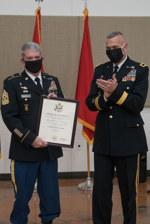 Soldiers pose with certificate