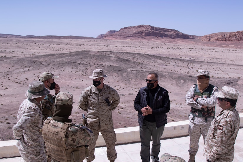 Maj. Josh Roberts discuss the training exercise between the SCT-J U.S. Marines and the Jordanian forces. The training exercise consisted of mortar teams, artillery teams and a Jordan Marine team working together toward a final live fire exercise.