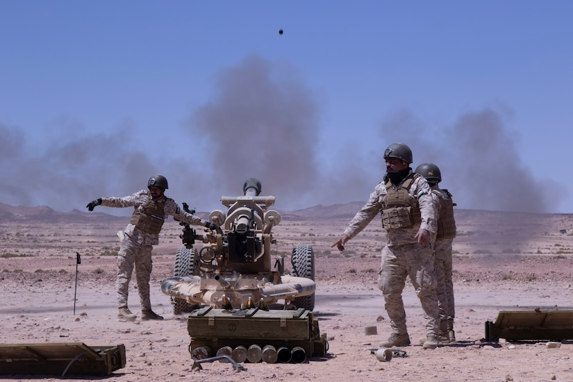 QRF Brigade field artillery gun crew fire the M119A2 105mm Howitzer at the Al Quwayrah Training Area, Jordan. The artillery gun crew, a mortar crew, and Jordanian Royal Marines participated in live fire exercise over the course of a week.