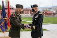 Maj. Gen. Michael J. Turley, adjutant general of the Utah National Guard, presents Brig. Gen. Thomas C. Fisher, the former commander of the Utah Army Guard Land Component Command, with a flag during his retirement ceremony on Camp Williams, Utah, May 1, 2021. Turley remarked that Fisher was truly a teacher of Soldiers and never forgot about how important each individual Soldier is to the units. (U.S. Army National Guard photo taken by Spc. Alejandro Lucero)