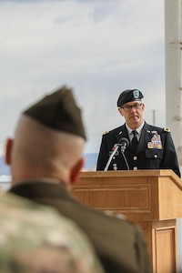 Soldier gives speech from podium