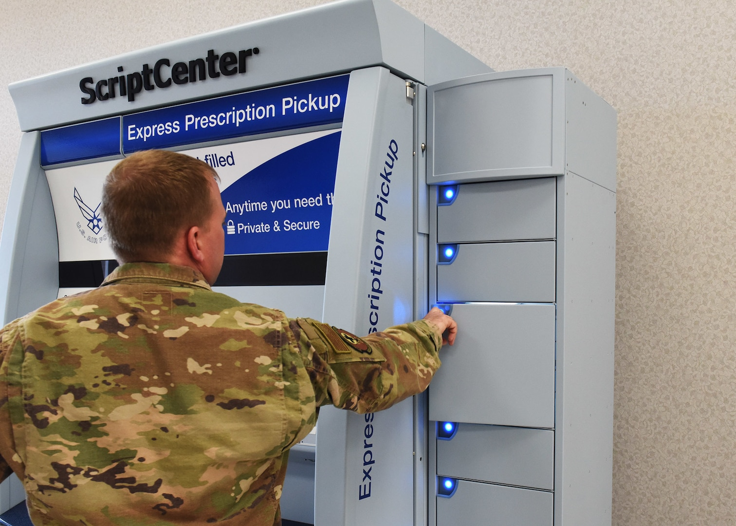 Service member opens a locker in the ScriptCenter
