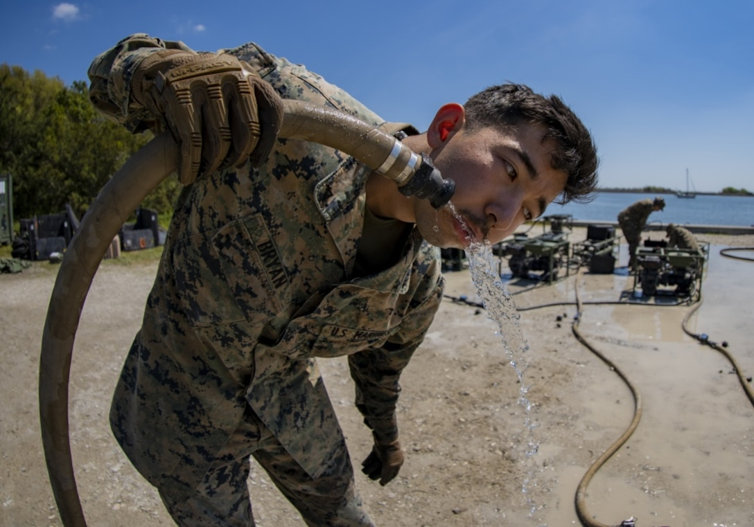 A U.S. Marine reviews recently purified water's chlorine level during the command post exercise at Camp Lejeune, North Carolina, April 8.