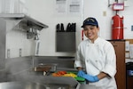 Petty Officer 3rd Class Samantha Waialae, a culinary specialist, poses for an environmental portrait in the galley of Coast Guard Station Cape Charles in Cape Charles, Virginia, March 21, 2019. Culinary specialist is one of four critical ratings for Coast Guard recruiting efforts. U.S. Coast Guard photo by Matt Sprague.