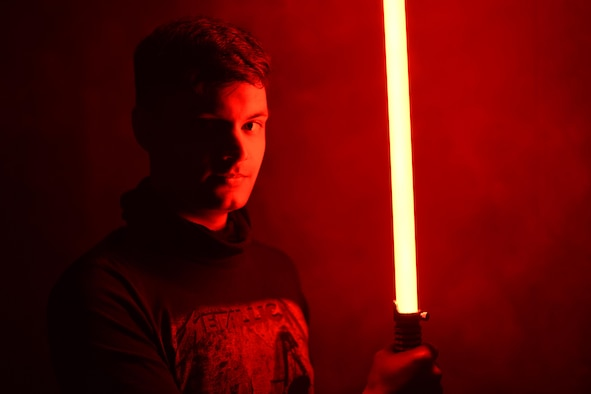 person holds lightsaber