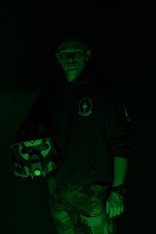 person hold helmet