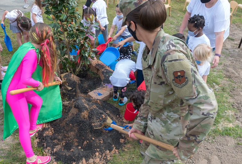 U.S. Air Force Col. Heather Blackwell, 81st Training Wing commander, plants a tree in honor of Arbor Day along with a preschool class at the child development center during the Arbor Day Celebration at Keesler Air Force Base, Mississippi, April 30, 2021. A proclamation was also read during the event. (U.S. Air Force photo by Andre' Askew)