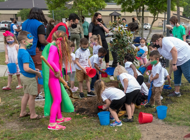 A preschool class at the child development center plants a tree in honor of Arbor Day during the Arbor Day Celebration at Keesler Air Force Base, Mississippi, April 30, 2021. A proclamation was also read during the event. (U.S. Air Force photo by Andre' Askew)