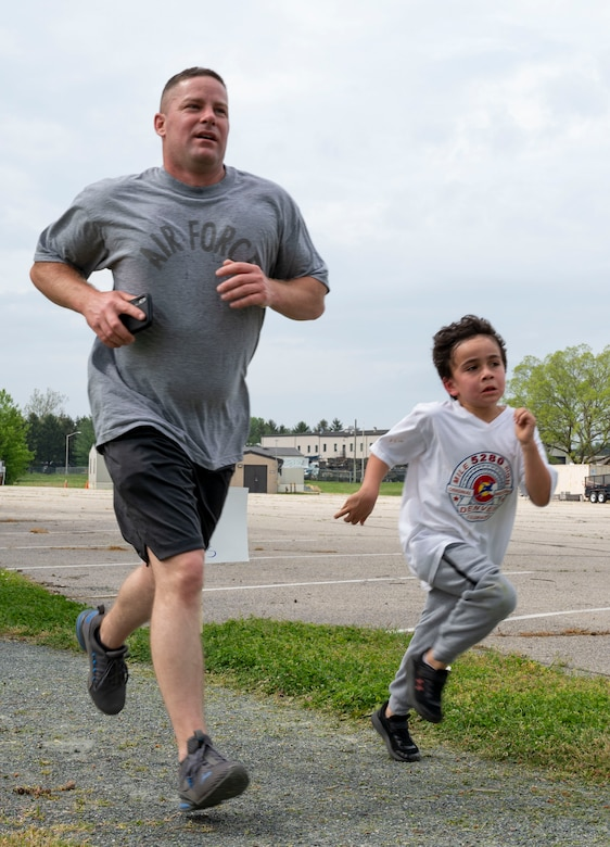Chief Master Sgt. David Teets, 436th Aerial Port Squadron superintendent, and his son, Tony, run in the Stop Asian American Pacific Islander Hate 5K on Dover Air Force Base, Delaware, May 3, 2021. The run raised awareness about discrimination Asian Americans and Pacific Islanders face in the U.S. (U.S. Air Force photo by Airman 1st Class Cydney Lee)