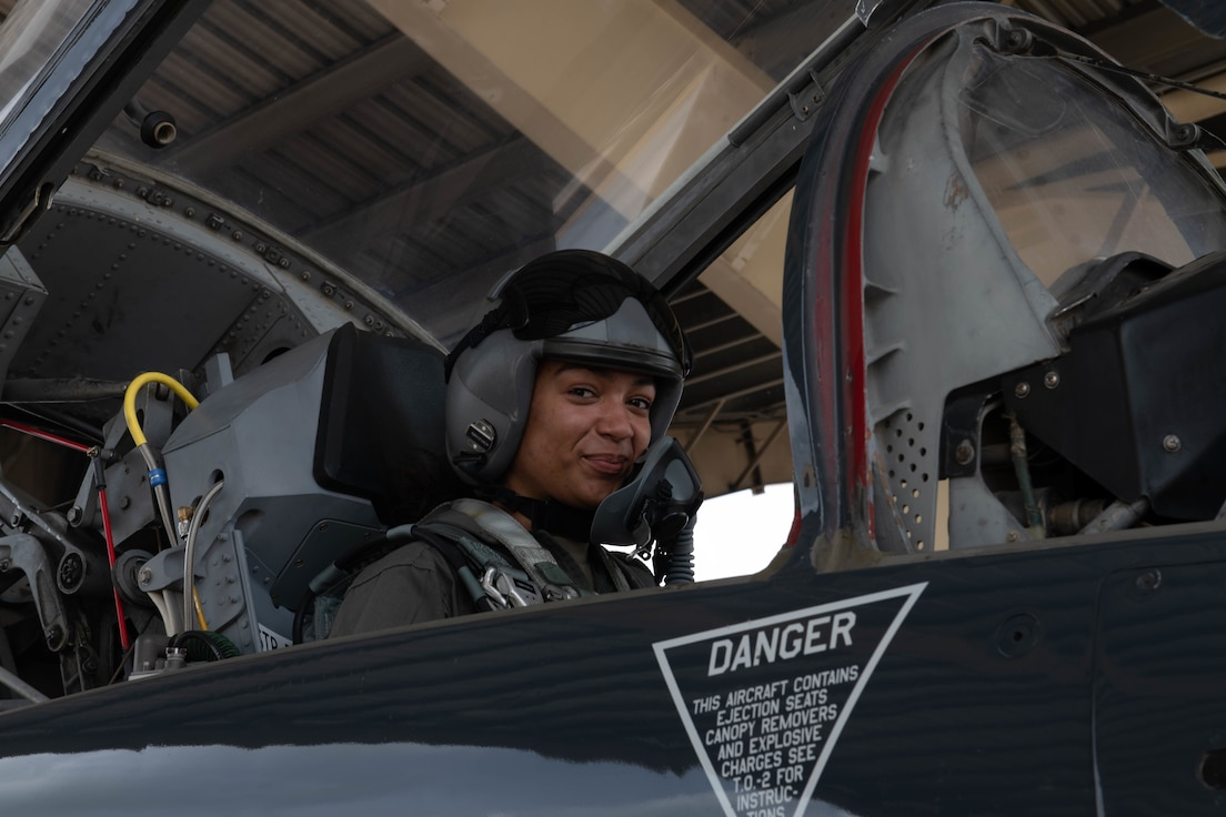 U.S. Air Force Staff Sgt. Alana Mullins, a 509th Operations Support Squadron radar, airfield, and weather systems technician, prepares for a flight in the T-38 Talon at Whiteman Air Force Base, Missouri, April 28, 2021. T-38 familiarization flights give non-flying Airmen hands on experience with the airframes they support. (U.S. Air Force photo by Airman 1st Class Devan Halstead)