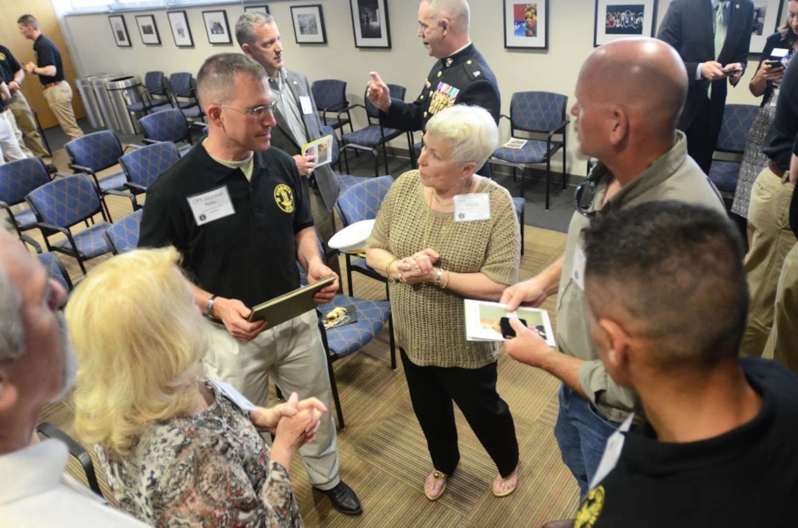 An officer candidates in class 58 of the Virginia Army National Guard Officer Candidate School speaks with the family of Capt. Harry Q. Rose at a ceremony commemorating the 58th birthday of the Virginia OCS April 19, 2016, at J. Sargeant Reynolds Community College's Downtown Campus in Richmond, Virginia. Rose, a graduate of Class VIII, was killed in Vietnam in 1969 and remains the only Virginia OCS graduate to have been killed in action. (Photo by Master Sgt. A.J. Coyne, Virginia Guard Public Affairs)