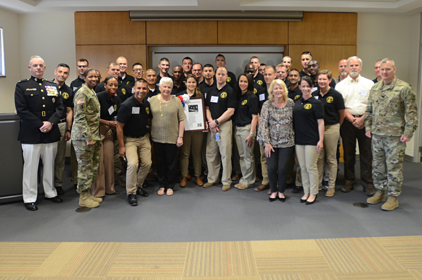 Officer candidates, graduates and cadre of the Virginia Army National Guard Officer Candidate School celebrate its 58th birthday with a ceremony April 19, 2016, at J. Sargeant Reynolds Community College's Downtown Campus in Richmond, Virginia. Officer candidates in Class 58, who are scheduled to graduate in August 2016, organized the ceremony, which included the family of Capt. Harry Q. Rose, a graduate of Class VIII who was killed in Vietnam in 1969 and remains the only Virginia OCS graduate to have been killed in action. (Photo by Master Sgt. A.J. Coyne, Virginia National Guard Public Affairs)