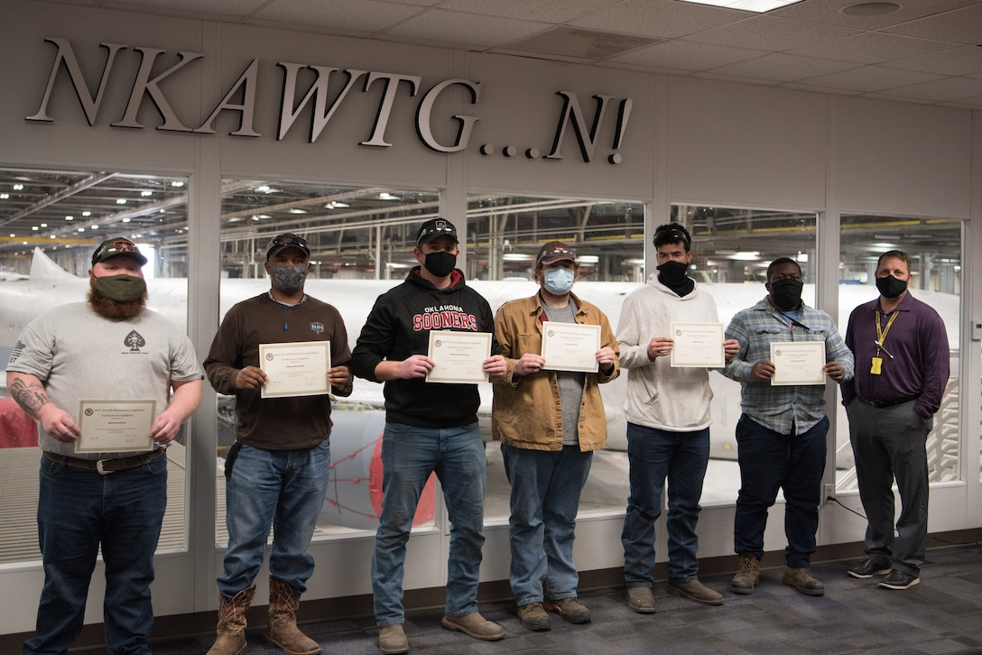 Graduates of the sheet metal vocational program pose for a group photo.