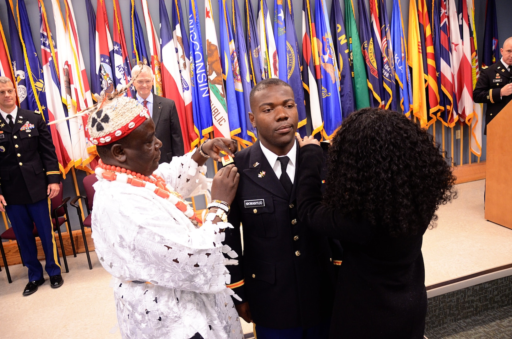 Second Lt. Abando A. Nkwanyou receives his lieutenant bars during a commissioning ceremony held April 29, 2018, at Fort Pickett, Virginia. (U.S. Army National Guard photo by Sgt. 1st Class Terra C. Gatti)