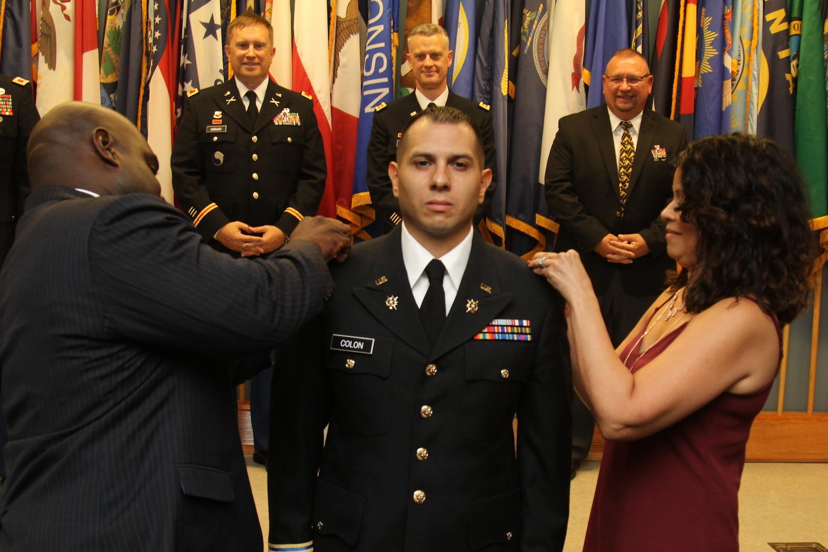 The Virginia Army National Guard welcomes 14 new lieutenants to its ranks with the commissioning of Officer Candidate School Class 60 and 61B Aug. 25, 2018, at Fort Pickett, Virginia. Class 60 was the traditional OCS program that runs nearly two years and taught by a cadre from the Fort Pickett-based 3rd Battalion, 183rd Regiment, Regional Training Institute, and Class 61B was the eight-week Accelerated OCS program at Fort McClellan, Alabama. The ceremony marked the end of a journey for the candidates as they took their oaths of office, received their OCS diplomas and their second lieutenant bars and delivered their first salute as new officers. (U.S. Army National Guard photo by Staff Sgt. Matt Lyman)