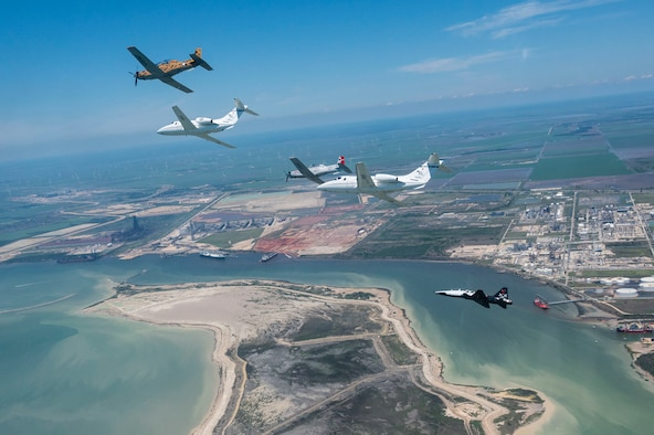 A six-ship dissimilar formation consisting of two T-1A Jayhawks, two T-38 Talons, and two T-6A Texan II aircrafts from Laughlin Air Force Base, Texas, practice advanced maneuvering May, 2, 2021. Instructor pilots from the 434th, 87th and 85th Flying Training Squadrons demonstrated the flying proficiency all Air Force student pilots receive during their 52-week Specialized Undergraduate Pilot Training, before being assigned their operational career airframe. (U.S. Air Force photo by Airman 1st Class David Phaff)