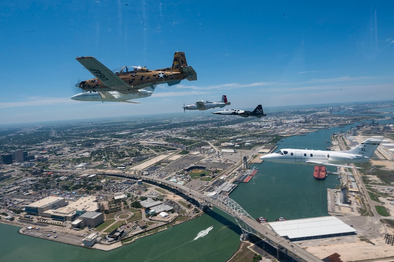 A six-ship dissimilar formation consisting of two T-1A Jayhawks, two T-38 Talons, and two T-6A Texan II aircrafts from Laughlin Air Force Base, Texas, practice advanced maneuvering May, 2, 2021. Instructor pilots from the 434th, 87th and 85th Flying Training Squadrons demonstrated the flying proficiency all Air Force student pilots receive during their 52-week Specialized Undergraduate Pilot Training, before being assigned to their operational career airframe. (U.S. Air Force photo by Airman 1st Class David Phaff)