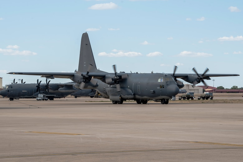 An AC-130W aircraft, piloted by members of the 551st Special Operations Squadron, pulls in after their fini flight at Cannon Air Force Base, N.M., April 29, 2021. The squadron will be officially made inactive June 15, 2021, but the flight marked the end of training at the 551 SOS. (U.S. Air Force photo by Senior Airman Vernon R. Walter III)