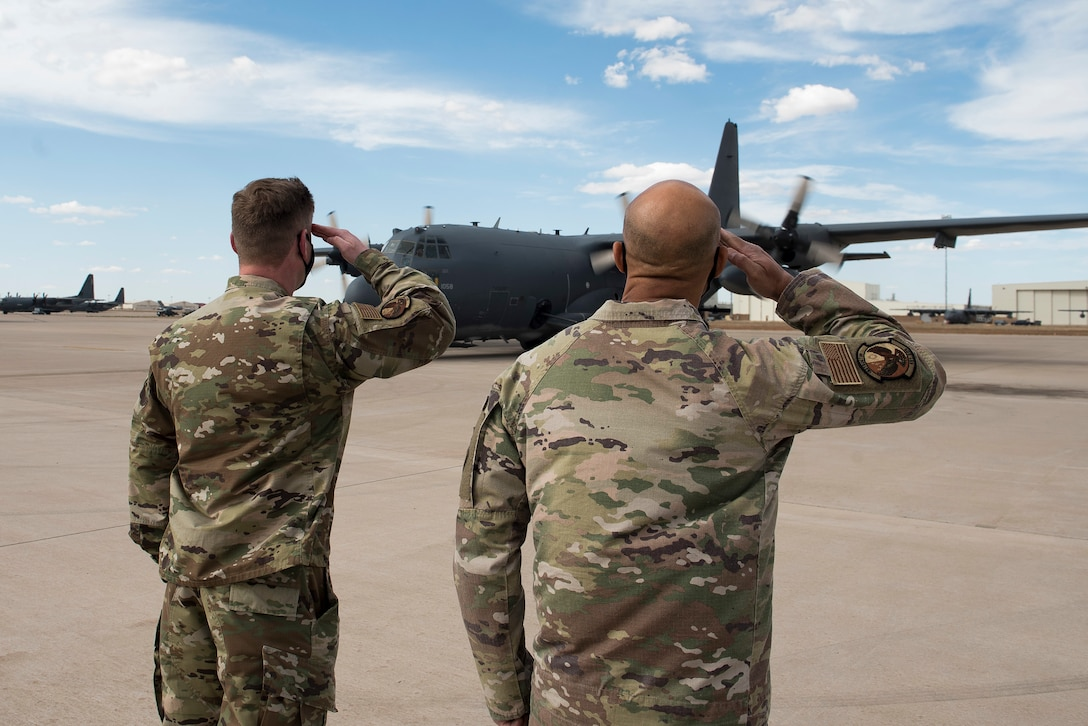 Lt. Col. Kris Airkens, 551st Special Operations Squadron commander, and Senior Master Sgt. Aaron Drain, 551 SOS senior enlisted leader, salute an AC-130W aircraft as it pulls in after a flight at Cannon Air Force Base, N.M., April 29, 2021. The squadron, a tenant unit of the 492nd Special Operations Wing, has been at Cannon since July 24, 2009, after its reactivation. (U.S. Air Force photo by Senior Airman Vernon R. Walter III)