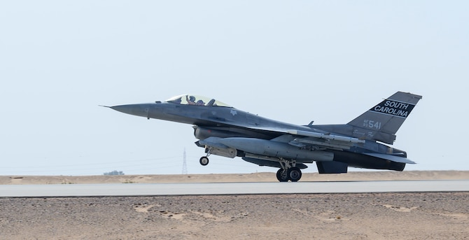"""A U.S. Air Force F-16CJ Fighting Falcon from South Carolina Air National Guard's 169th """"Swamp Fox"""" Fighter Wing lands on the flight line at Prince Sultan Air Base, Kingdom of Saudi Arabia, April 14, 2021. The Swamp Fox team has been deployed to PSAB to help bolster the defensive capabilities against potential threats in the region. (U.S. Air Force Photo by Senior Airman Samuel Earick)"""