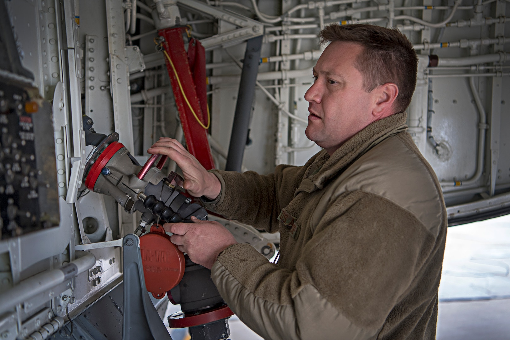 Tech. Sgt. Jason Jessup, 434th Maintenance Squadron, hooks a hose to a Grissom KC-135R Stratotanker to pump fuel on board. A $35 million Type III fuel hydrant system became operational at Grissom fueling unit capabilities into the future. (U.S. Air Force photo/Douglas Hays)