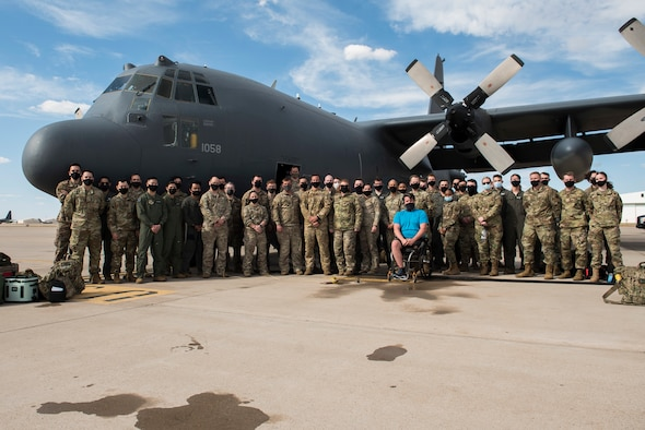 Members of the 551st Special Operations Squadron stand together for a group photo after a fini flight at Cannon Air Force Base, N.M., April 29, 2021. The 551 SOS will be standing down June 15, 2021. (U.S. Air Force photo by Senior Airman Vernon R. Walter III)