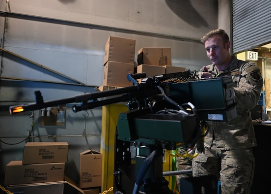 Staff Sgt. Phillip Hill, 37th Helicopter Squadron flight chief and evaluator special mission aviator, demonstrates the use of an aerial gunnery simulator, made to simulate the M240D rifle on the UH-1N Huey, April 28, 2021 at F.E. Warren Air Force Base, Wyo. The simulation is likely to save the squadron millions of dollars in ammunition, fuel costs and range fees.