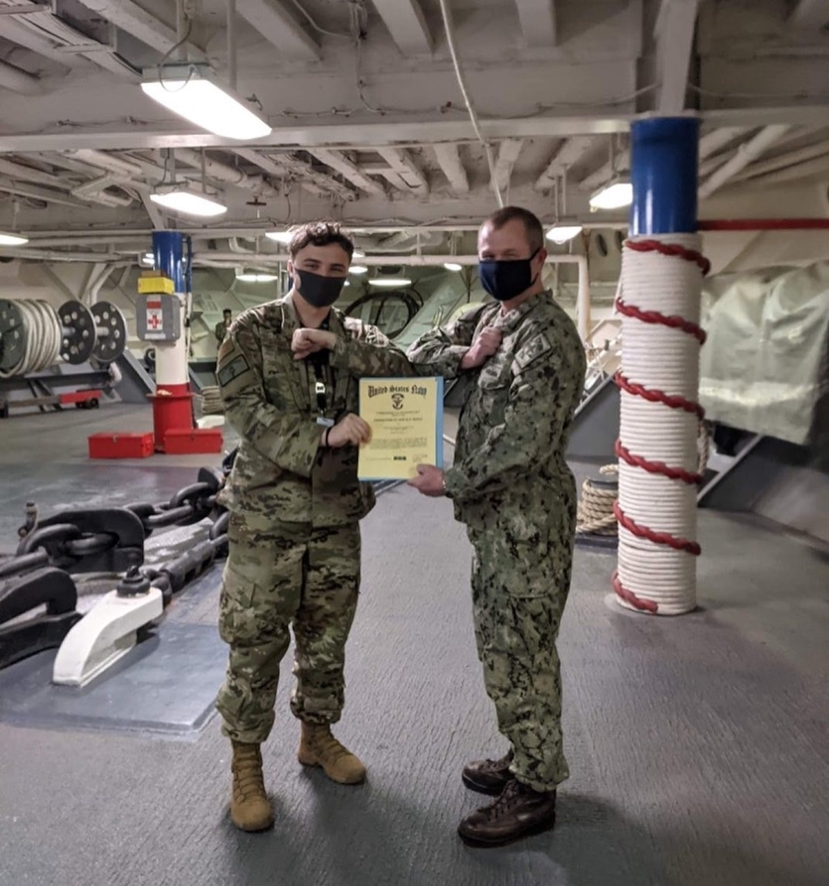U.S. Air Force Senior Airman Alexander Garrett received an Armed Forces Service Medal from the ship's information officer for his work aboard the U.S.S. Blue Ridge (LCC-19). The 3rd Operations Support Squadron intelligence analyst was the only Airman on board.